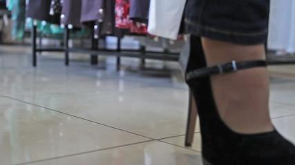 woman walking  in high heels  in a shop