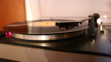 Video with running old gramophone turntable with disc.
