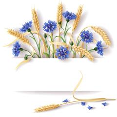Wheat ears and cornflowers