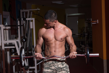 Young Man Exercise With Barbell