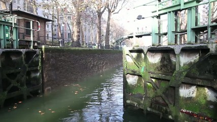 Gate opening on Saint Martin canal, Paris, France.