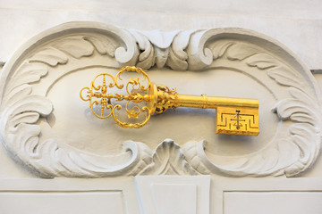 Gold key, house motif. Prague, Czech Republic