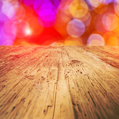 Christmas holiday background with empty wooden deck table over f