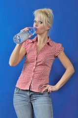 Blond woman drinking water