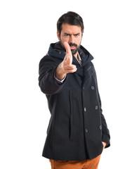 Man making gun gesture