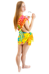 sexy woman wearing a bright pareo with sunglasses standing