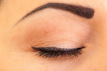 close female eye with make-up, closeup