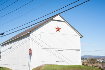Mennonite star and white building.
