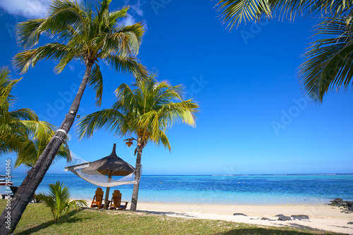 Tuinposter Eiland Mauritius beach with chairs and umbrellas