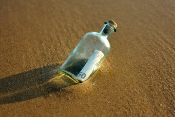 50 euro in a bottle on the beach