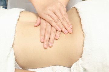 Masseur applying  massage techniques  to  relax  back muscles in