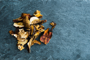 Closeup on dried mushrooms on stone substrate