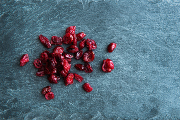 Closeup on dried lingonberries on stone substrate
