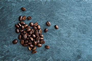 Closeup on coffee beans on stone substrate