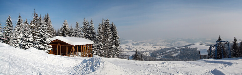 Ski mounains panorama, track, wooden building, snow, sunny day
