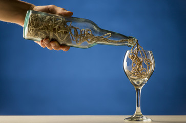 Man pouring string into a wineglass