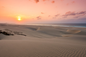 Sunset on sand dunes  in Chaves beach Praia de Chaves in Boavist