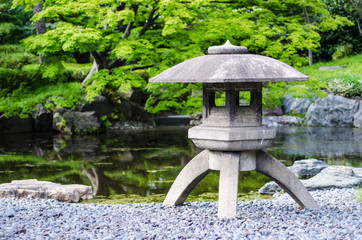 japanese traditional stone lantern in a park in tokyo