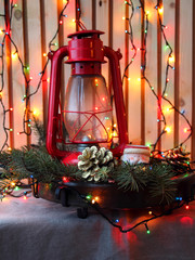 Still life with lantern and Christmas tree branches.