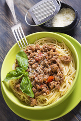 Spaghetti with bolognese sauce and parmesan cheese.