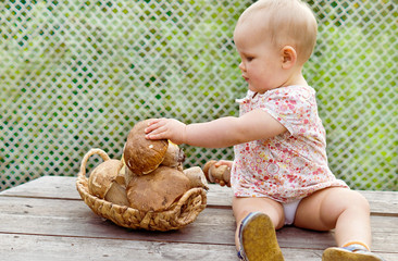 One-year-old girl  with mushrooms porcini