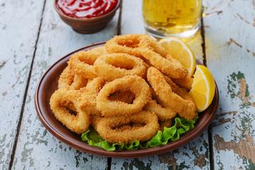 fried squid rings, breaded with lemon
