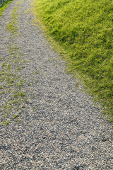 Trail with pebble and green grass