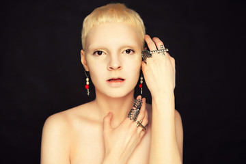 androgynous girl in the studio on textured background