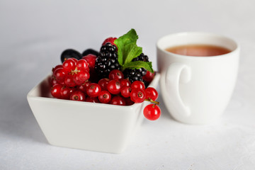 blackberry, currant and mint with a cup of tea