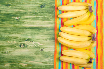 banana on a green chalkboard on colored napkin left space for te