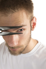 Man with pliers close to eye