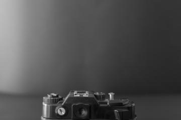Old SLR camera on a dark background