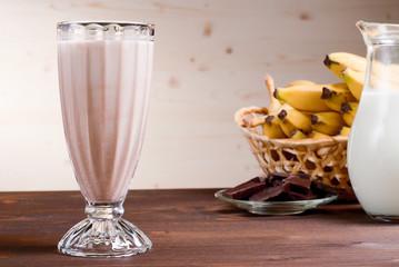 banana chocolate cocktail behind bananas and chocolate milk
