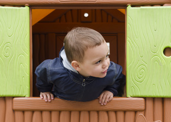 Child playing in a children playhouse.