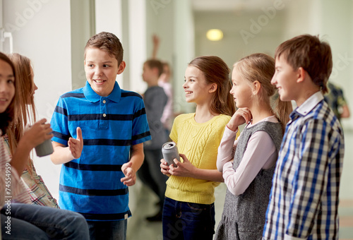 group of school kids with soda cans in corridor - 74554959