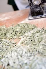 Fresh green pasta on table. Fettuccini homemade.