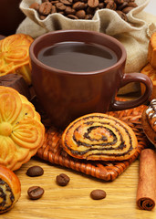 Cup of coffee with biscuits, coffee beans in bags and cinnamon s