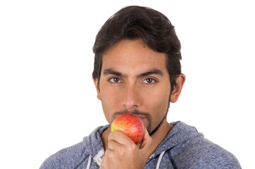 handsome young man biting red apple