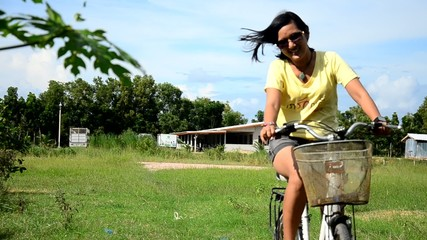 Thai women riding bicycle in the garden at Phattalung