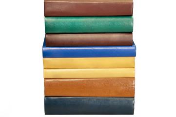 Multi-colored books on a white background