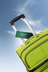 Helsinki, Finland. Green suitcase with label