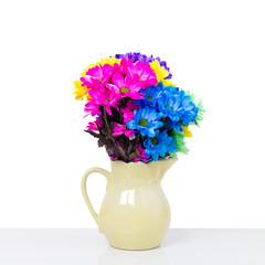 Colorful fresh flowers in a jug