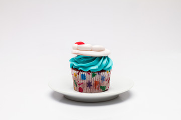Christmas cupcake with butter cream icing.