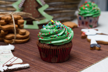 Christmas Treats. Cakes, cupcakes, confection. Light background