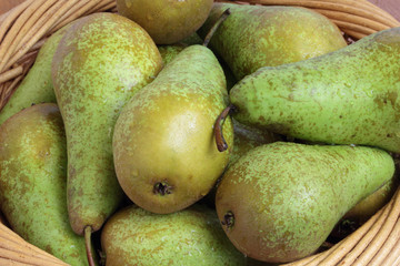 Few pears in a basket.