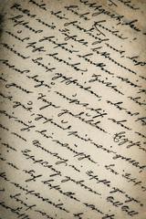 old handwritten text. grunge vintage paper background
