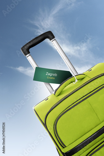 canvas print picture Zagreb, Croatia. Green suitcase with label