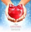 Holiday christmas background with hands holding gift box. Concep