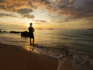 Silhouette of Man Standing at the beach