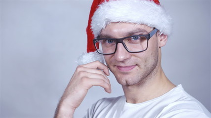 Close up of handsome cheerful christmas man posing in studio.